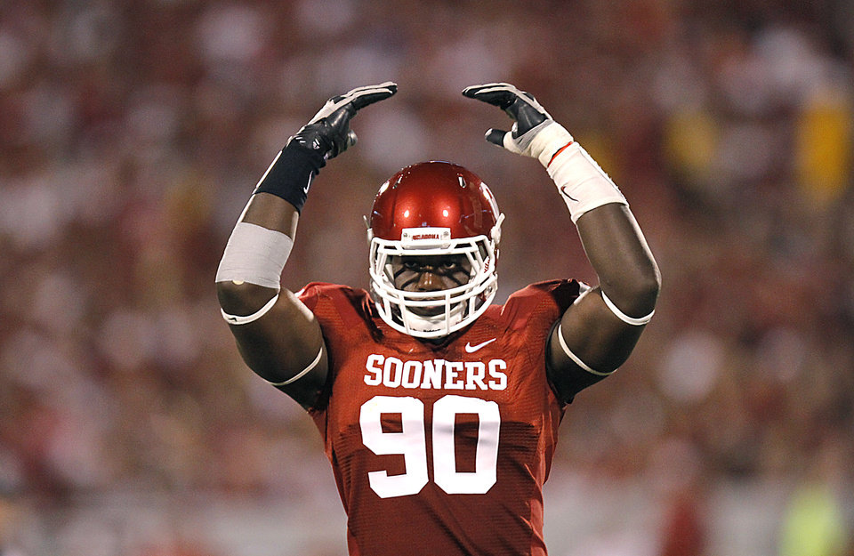 Oklahoma's David King (90) gets the crowd into the game during the college football game between the University of Oklahoma Sooners (OU) and the University of Missouri Tigers (MU) at the Gaylord Family-Memorial Stadium on Saturday, Sept. 24, 2011, in Norman, Okla. Photo by Chris Landsberger, The Oklahoman
