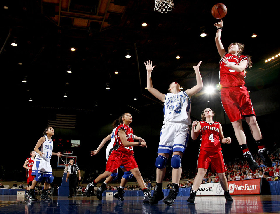 Photo - Ft. Gibson's Taylor Wilson (5) shoots in front of Vinita's Caitlyn Spurgeon (32) during the girls 4A semi-inal between Fort Gibson and Vinita at the State Fair Arena, Friday, March 13, 2009, in Oklahoma City. PHOTO BY SARAH PHIPPS, THE OKLAHOMAN