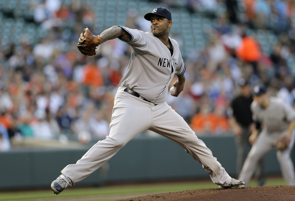 Photo - New York Yankees starting pitcher CC Sabathia throws to the Baltimore Orioles in the first inning of a baseball game in Baltimore, Monday, May 20, 2013. (AP Photo/Patrick Semansky)