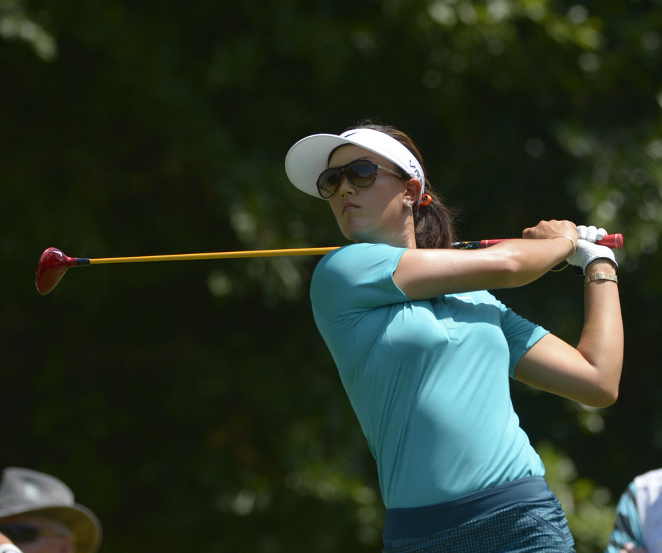 Photo - Michelle Wie hits her tee shot on the fifth hole in the second round of the Airbus LPGA Classic golf tournament at Magnolia Grove on Friday, May 23, 2014, in Mobile, Ala. (AP Photo/G.M. Andrews)