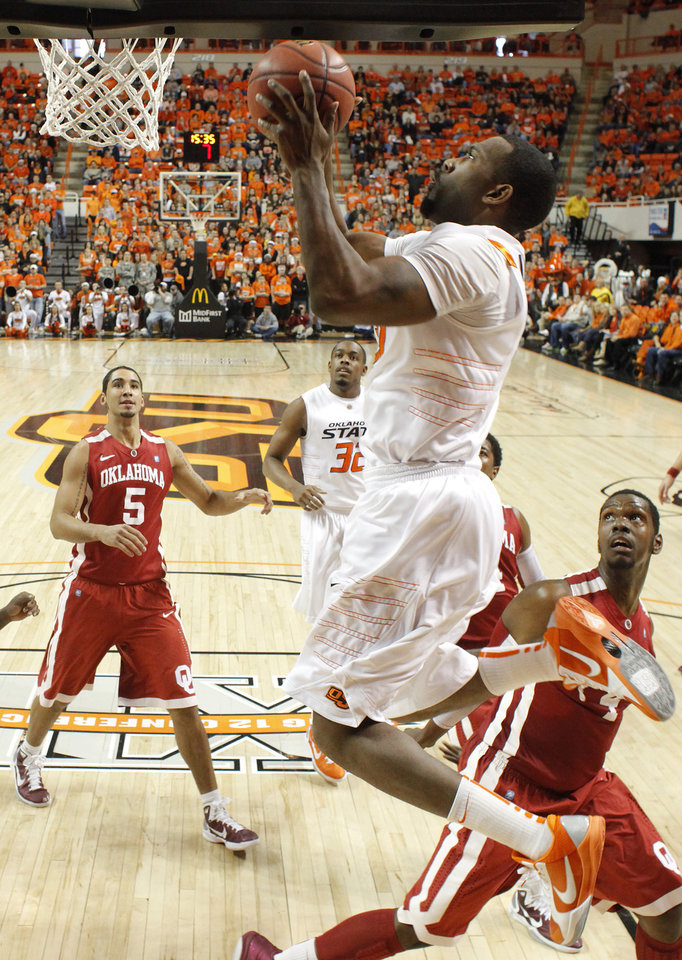 Photo - Oklahoma State's Matt Pilgrim (31) goes to the basket between Oklahoma's C.J. Washington (5) and Andrew Fitzgerald (4) during the Bedlam men's college basketball game between the University of Oklahoma Sooners and Oklahoma State University Cowboys at Gallagher-Iba Arena in Stillwater, Okla., Saturday, February, 5, 2011. Photo by Bryan Terry, The Oklahoman