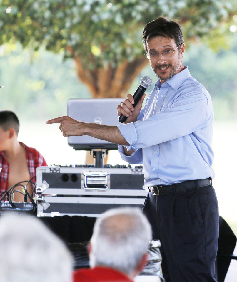 Photo - Frank Volpe speaks during the Victimsofiminentdomain.com rally at Choctaw Creek Park, in Choctaw, against the eastern Oklahoma county turnpike leg that the Oklahoma Turnpike Authority has proposed building Friday, August 12, 2016. Photo by Doug Hoke, The Oklahoman