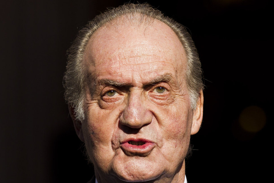 Photo - FILE - In this Tuesday, Dec. 27, 2011, file photo Spain's King Juan Carlos leaves after the official opening of the Parliament, in Madrid. Spain's King Juan Carlos plans to abdicate and pave the way for his son, Crown Prince Felipe, to take over, Spanish Prime Minister Mariano Rajoy told the country Monday in an announcement broadcast nationwide. The 76-year-old Juan Carlos oversaw his country's transition from dictatorship to democracy but has had repeated health problems in recent years. (AP Photo/Daniel Ochoa de Olza, File)