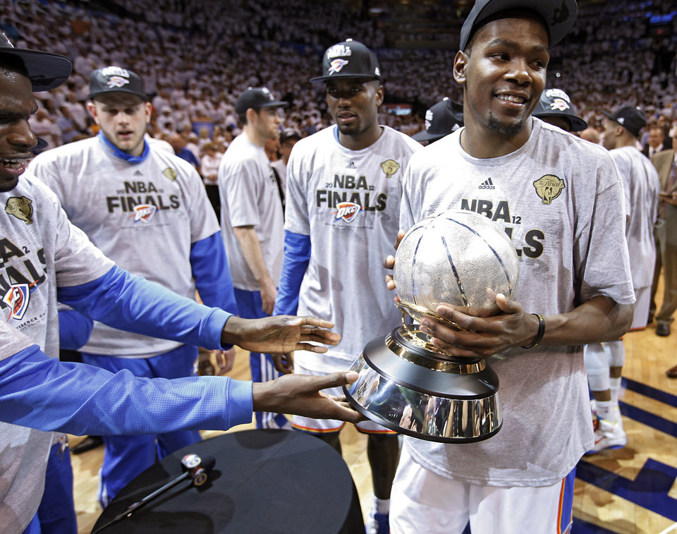 Kevin Durant holds the NBA Western Conference Championship Trophy after the 107-99 win over San Antonio during Game 6 of the Western Conference Finals between the Oklahoma City Thunder and the San Antonio Spurs in the NBA playoffs at the Chesapeake Energy Arena in Oklahoma City, Wednesday, June 6, 2012. Photo by Chris Landsberger, The Oklahoman