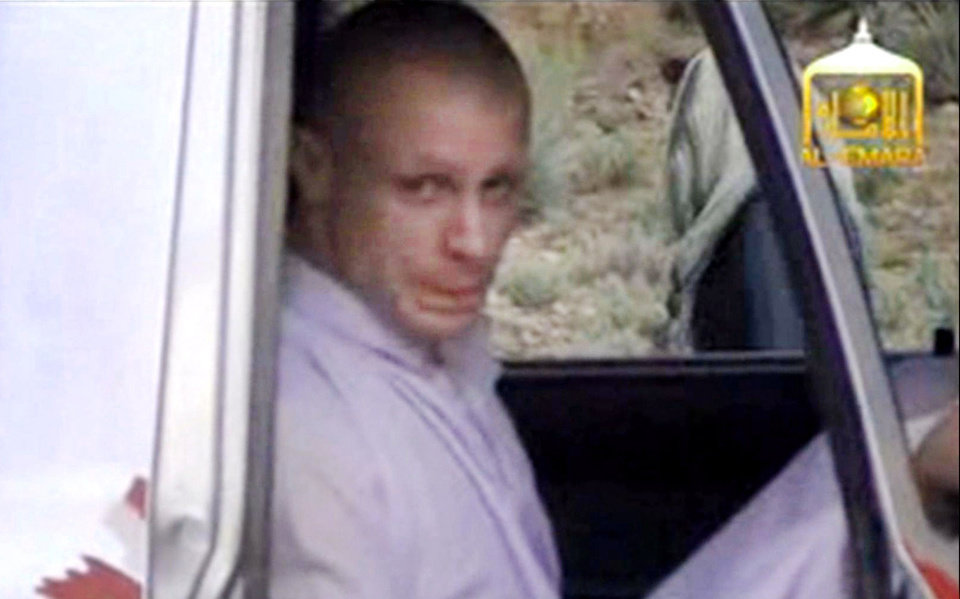 Photo - In this image taken from video obtained from Voice Of Jihad Website, which has been authenticated based on its contents and other AP reporting, Sgt. Bowe Bergdahl sits in a vehicle guarded by the Taliban in eastern Afghanistan. The Taliban have released a video showing the handover of Bergdahl to U.S. forces in eastern Afghanistan. The video, emailed to media, shows Bergdahl in traditional Afghan clothing sitting in a pickup truck parked on a hillside. Defense Secretary Chuck Hagel will face angry lawmakers Wednesday as he becomes the first Obama administration official to testify publicly about the controversial prisoner swap with the Taliban. Hagel is scheduled to appear before the House Armed Services Committee, which is investigating the deal that secured the end of Bergdahl's five-year captivity. In exchange, the U.S. transferred five high-level Taliban detainees to the Gulf emirate of Qatar.  (AP Photo/Voice Of Jihad Website via AP video)