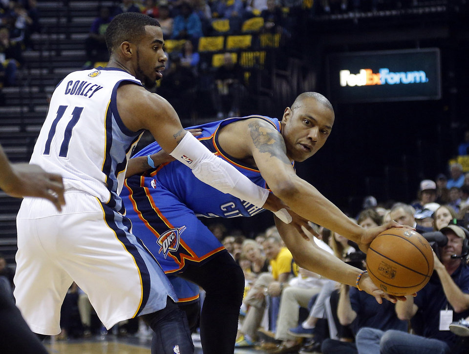Photo - Oklahoma City's Caron Butler (2) looks to pass around Memphis' Mike Conley (11) during Game 6  in the first round of the NBA playoffs between the Oklahoma City Thunder and the Memphis Grizzlies at FedExForum in Memphis, Tenn., Thursday, May 1, 2014. Photo by Bryan Terry, The Oklahoman