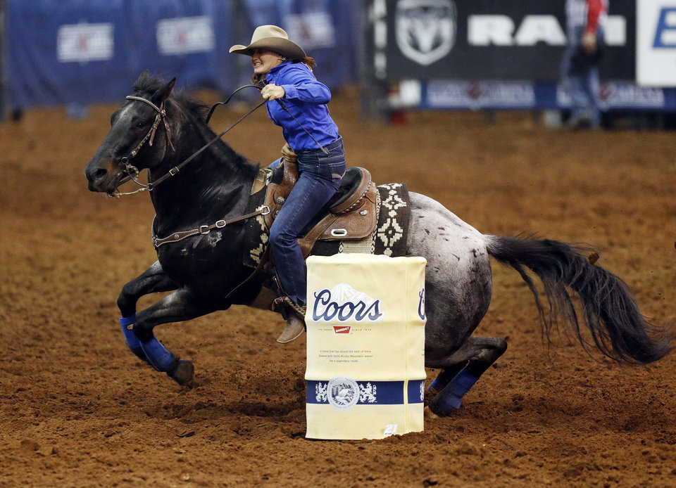 Photo - Trula Churchill of Valentine, N.E., competes in barrel racing during the National Circuit Finals Rodeo at the Lazy E Arena in Guthrie, Okla., Saturday afternoon, April 12, 2014. Photo by Nate Billings, The Oklahoman