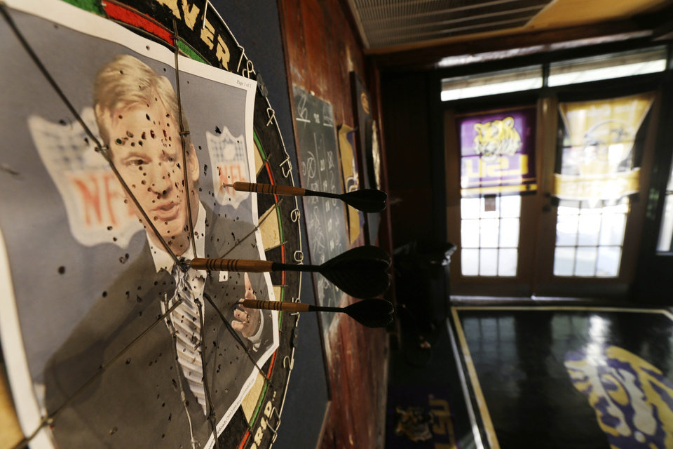 "A photo of NFL commissioner Roger Goodell is seen on a dartboard inside the Parkview Tavern in New Orleans, Friday, Jan. 25, 2013. New Orleans is celebrating the return of coach Sean Payton after a season\'s NFL banishment as a result of the ""Bountygate"" scandal. But the good feeling does not extend to Goodell, who suspended Payton and other key players and coaches last year in the alleged pay-for-pain scheme. He is being ridiculed here with a vehemence usually reserved for the city\'s multitude of scandal-scarred politicians.(AP Photo/Gerald Herbert)"