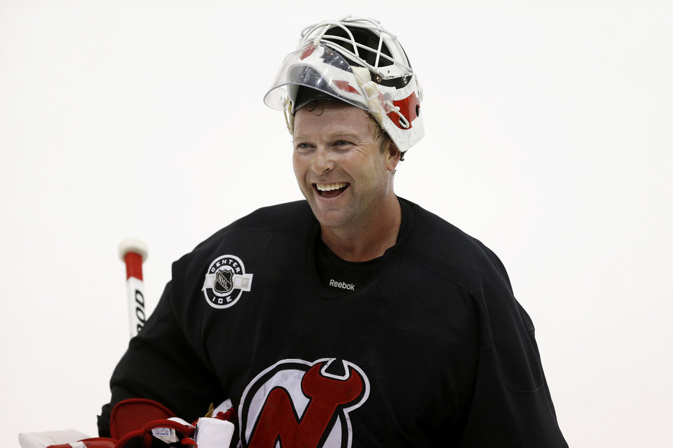 New Jersey Devils goalie Martin Brodeur reacts during the team's first official practice since the NHL hockey lockout ended, Sunday, Jan. 13, 2013, in Newark, N.J. (AP Photo/Julio Cortez)