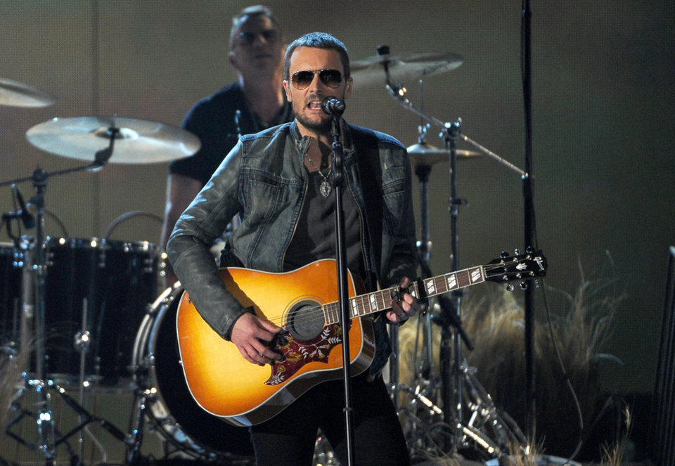 Photo - Eric Church performs on stage at the 49th annual Academy of Country Music Awards at the MGM Grand Garden Arena on Sunday, April 6, 2014, in Las Vegas. (Photo by Chris Pizzello/Invision/AP)
