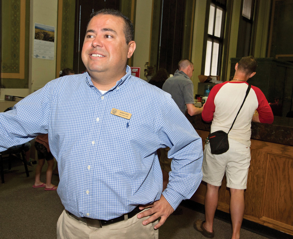 Photo - Pueblo County Clerk Bo Ortiz talks about his decision to issue marriage licenses to same-sex couples on Friday, July 11, 2014, at the county courthouse in Pueblo, Colo.  (AP Photo, Chris McLean/The Pueblo Chieftain)