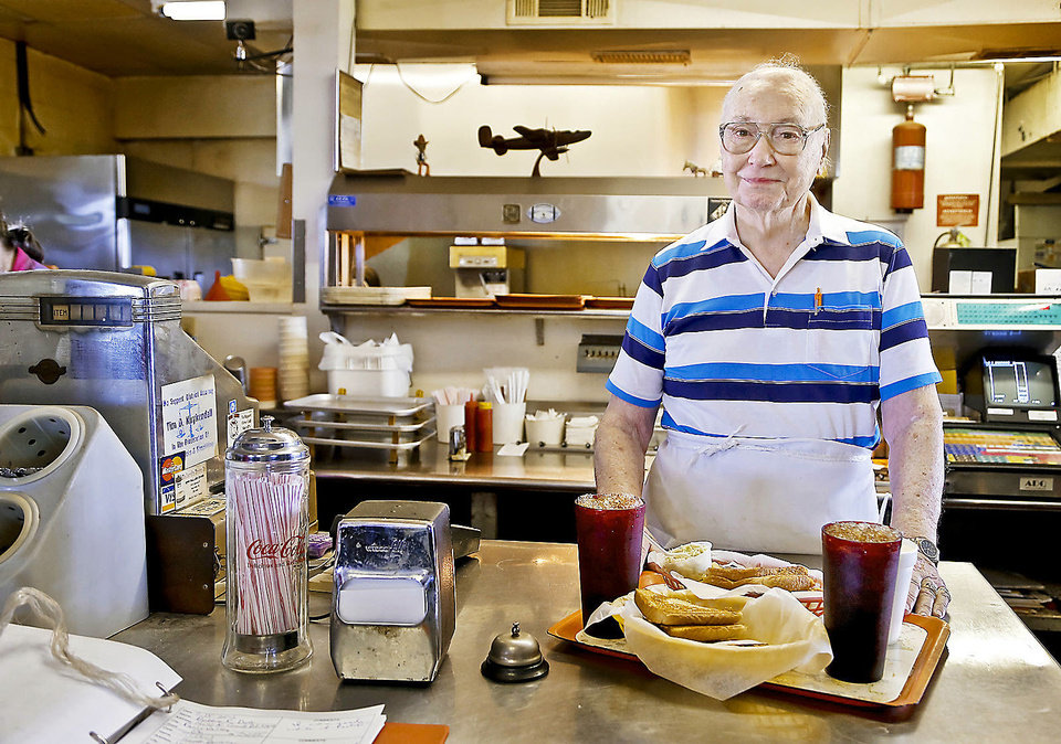 Photo - Owner Johnny Ballard poses for a photo Monday behind the counter at Ballard's Drive-In in Pauls Valley. Photos by Chris Landsberger, The Oklahoman