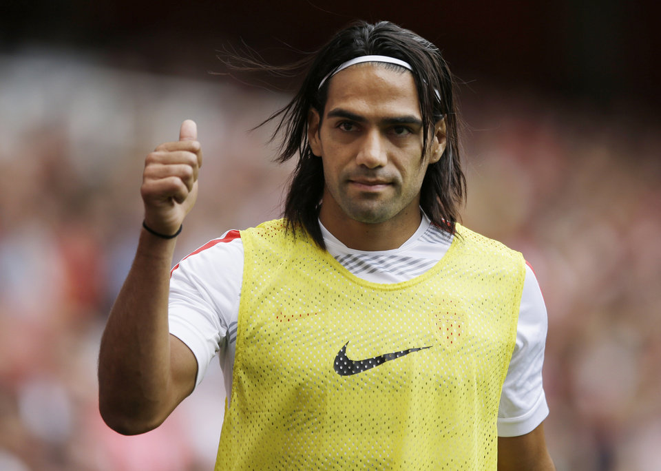 Photo - FILE - This is a Saturday, Aug. 2, 2014  file photo of AS Monaco player Radamel Falcao  as he gives a thumbs up to fans as he warms up on the sideline during the second half of the Emirates Cup soccer match between AS Monaco and Valencia at Arsenal's Emirates Stadium in London.  Radamel Falcao is set to join Manchester United on loan after the Premier League club agreed to a loan deal with Monaco, a person with knowledge of the deal said Monday Sept. 1, 2014.  (AP Photo/Matt Dunham, File)