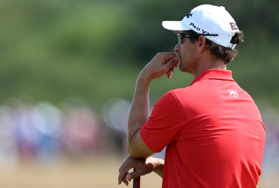 Photo - Adam Scott of Australia looks along the 8th fairway during the second day of the British Open Golf championship at the Royal Liverpool golf club, Hoylake, England, Friday July 18, 2014. (AP Photo/Scott Heppell)
