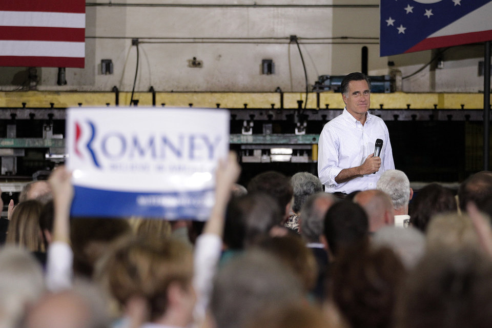 Photo -   A supporter holds up a sign as she listens to Republican presidential candidate, former Massachusetts Gov. Mitt Romney at a town hall-style meeting in Euclid, Ohio, Monday, May 7, 2012. (AP Photo/Jae C. Hong)