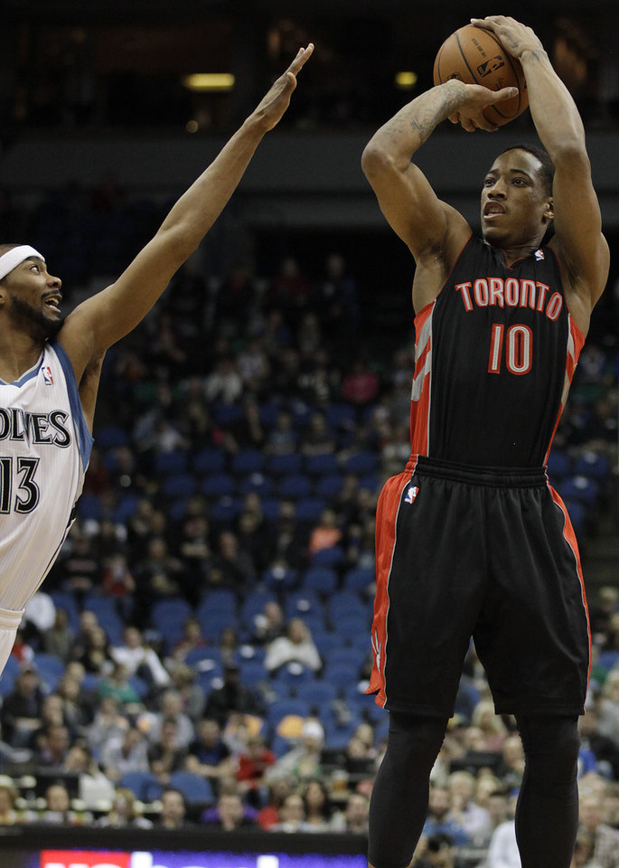 Photo - Toronto Raptors guard DeMar DeRozan (10) shoots against Minnesota Timberwolves guard Corey Brewer (13) in the first half of an NBA basketball game on Sunday, March 9, 2014, in Minneapolis. (AP Photo/Stacy Bengs)