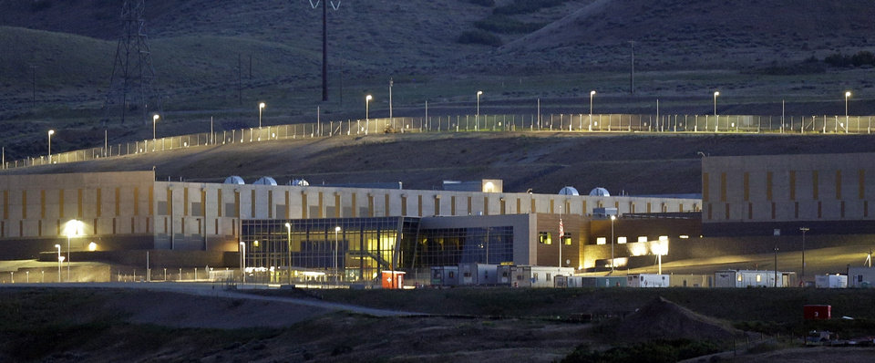 This Monday, June 10, 2013 photo shows a ground level view of Utah's NSA Data Center in Bluffdale, Utah.  The nation's new billion-dollar epicenter for fighting global cyberthreats sits just south of Salt Lake City, tucked away on a National Guard base at the foot of snow-capped mountains. The long, squat buildings span 1.5 million square feet, and are filled with super-powered computers designed to store massive amounts of information gathered secretly from phone calls and emails. (AP Photo/Rick Bowmer)