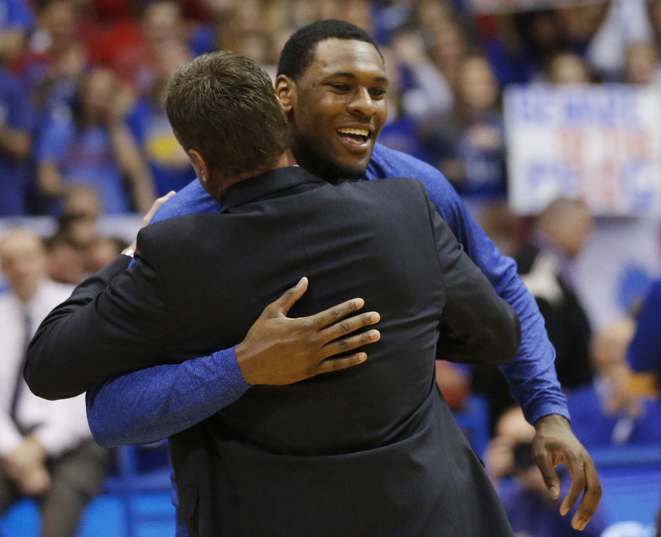 Photo - Kansas senior forward Tarik Black, rear hugs coach Bill Self before an NCAA college basketball game against Texas Tech in Lawrence, Kan., Wednesday, March 5, 2014. Black was one of three seniors playing their last home game. (AP Photo/Orlin Wagner)