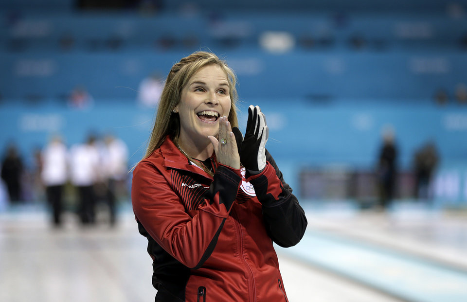 Photo - Canada's skip Jennifer Jones acknowledges cheers from her supporters after beating Britain in the women's curling competition at the 2014 Winter Olympics, Wednesday, Feb. 12, 2014, in Sochi, Russia. (AP Photo/Wong Maye-E)