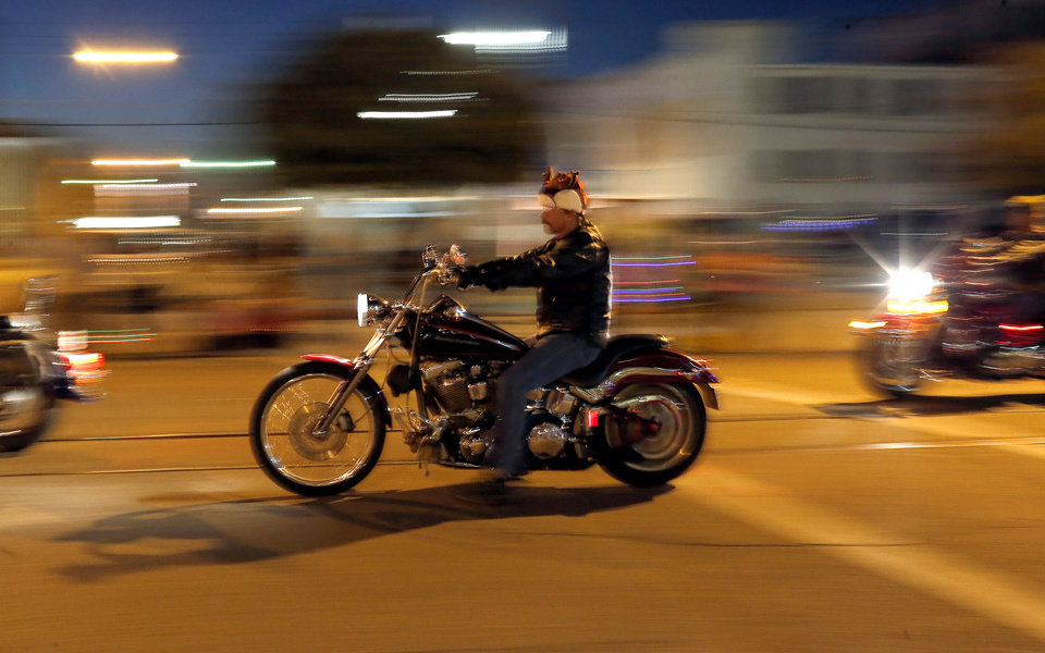 A motorcyclist rides during a Christmas parade in El Reno, Okla., Thursday,Nov. 29, 2012. Photo by Sarah Phipps, The Oklahoman