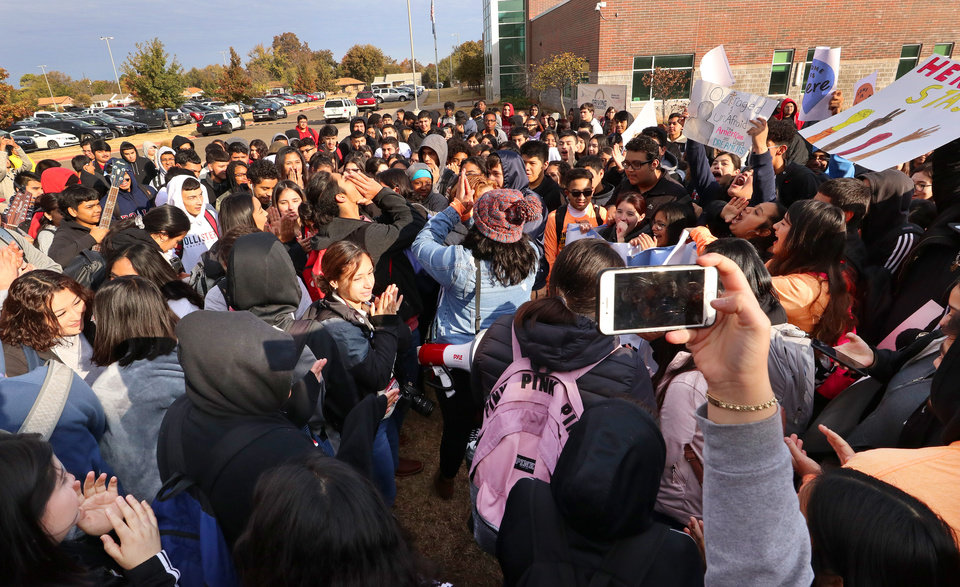 Photo - Brenda Lozano with Dream Action Oklahoma leads chants with the students at the DACA support rally at U.S. Grant High School Friday, November 8, 2019. Photo by Doug Hoke