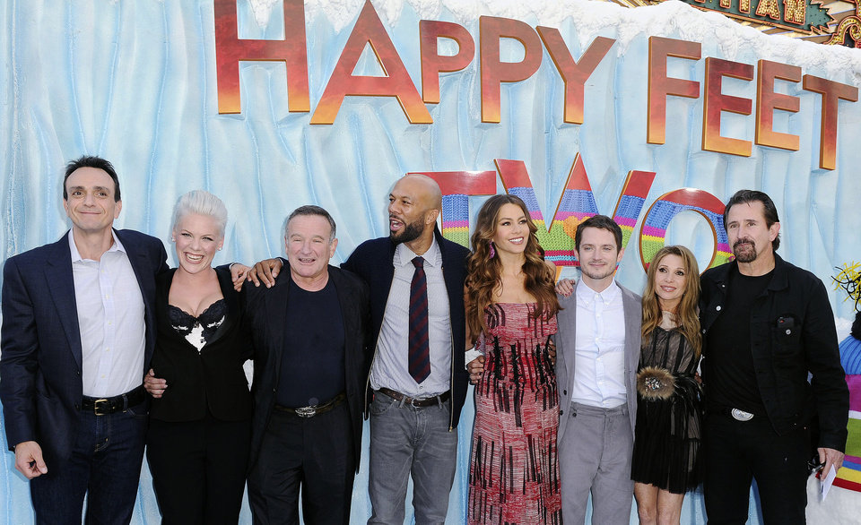 "Photo - From left, Hank Azaria, Alecia Moore, Robin Williams, Common, Sofia Vergara, Elijah Wood, E.G. Daily, and Anthony LaPaglia arrive at the premiere of ""Happy Feet Two"" at Grauman's Chinese Theater, Sunday, Nov. 13, 2011, in Los Angeles. ""Happy Feet Two"" will be released in 3-D and 2-D in select theaters Nov. 18, 2011. (AP Photo/Katy Winn) ORG XMIT: CAKW112"