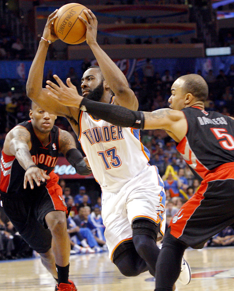 Photo - Oklahoma City's James Harden takes the ball past Toronto's Jerryd (CQ) Jerryd Bayless (right) and Sonny Weems during the second half of their NBA basketball game at the OKC Arena in downtown Oklahoma City on Sunday, March 20, 2011. The Raptors beat the Thunder 95-93. Photo by John Clanton, The Oklahoman