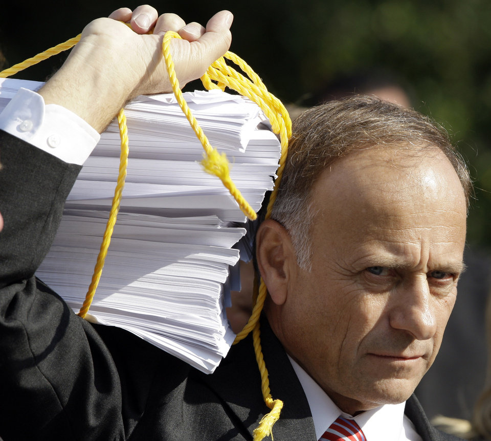 Photo - ** FOR USE AS DESIRED, YEAR END PHOTOS ** FILE - Rep. Steve King, R-Iowa, hold a copy of the health care bill on the West Front of the Capitol in Washington, in this Nov. 5, 2009 file photo, during a Republican health care news conference. (AP Photo/Alex Brandon, File) ORG XMIT: NYYE169
