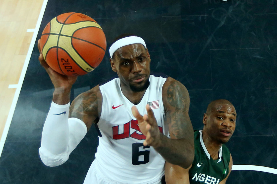 Photo -   Lebron James (6) of the United States shoots against Derrick Obasohan of Nigeria during a men's basketball preliminary round match at the 2012 Summer Olympics on Thursday, Aug. 2, 2012, in London. (AP Photo/Christian Petersen, Pool)