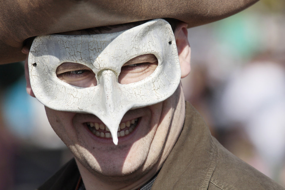 Charles Chiple, from Piedmont, sports a bird mask at the 34th Annual Medieval Fair at Reaves Park in Norman Sunday, March 28, 2010. Photo by Doug Hoke, The Oklahoman