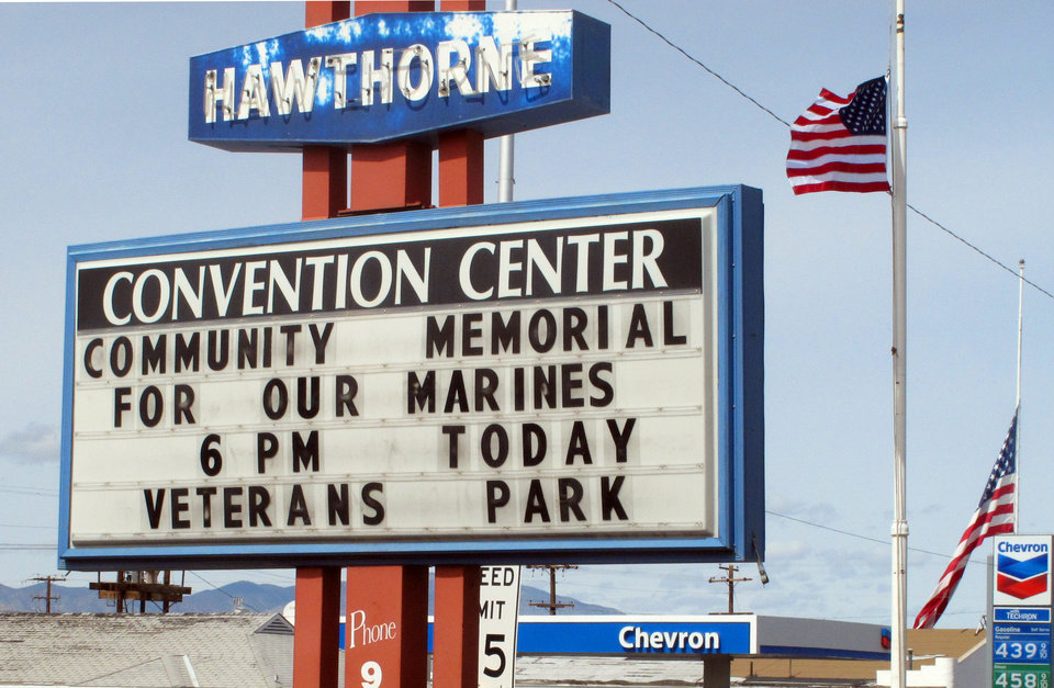 A sign telling residents about a memorial service is posted at the Convention Center in Hawthorne, Nev., near the Hawthorne Army Depot on Tuesday, March 19, 2013, where seven Marines were killed and several others seriously injured in a training accident Monday night, about 150 miles southeast of Reno in Nevada\'s high desert. (AP Photo/Scott Sonner)