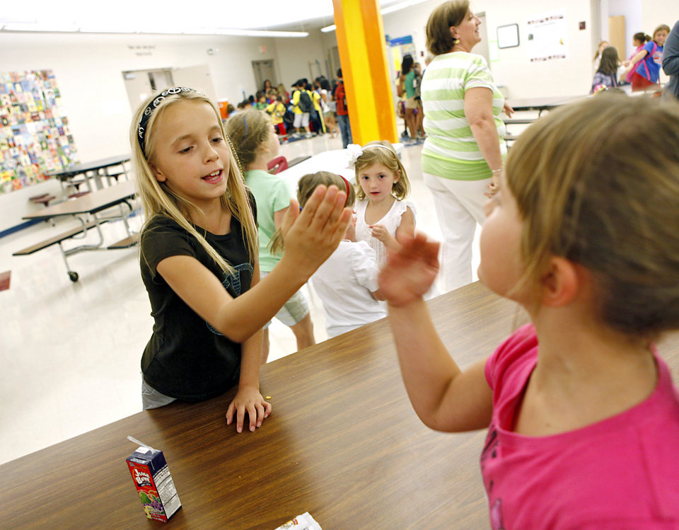 Kearra Schrock, age 10 (left) and Sydney Ricker (right) play together during the after-school Antler Care program at Deer Creek\'s Rose Union Elementary School in Oklahoma City on Tuesday, Aug. 23, 2011. Photo by John Clanton, The Oklahoman