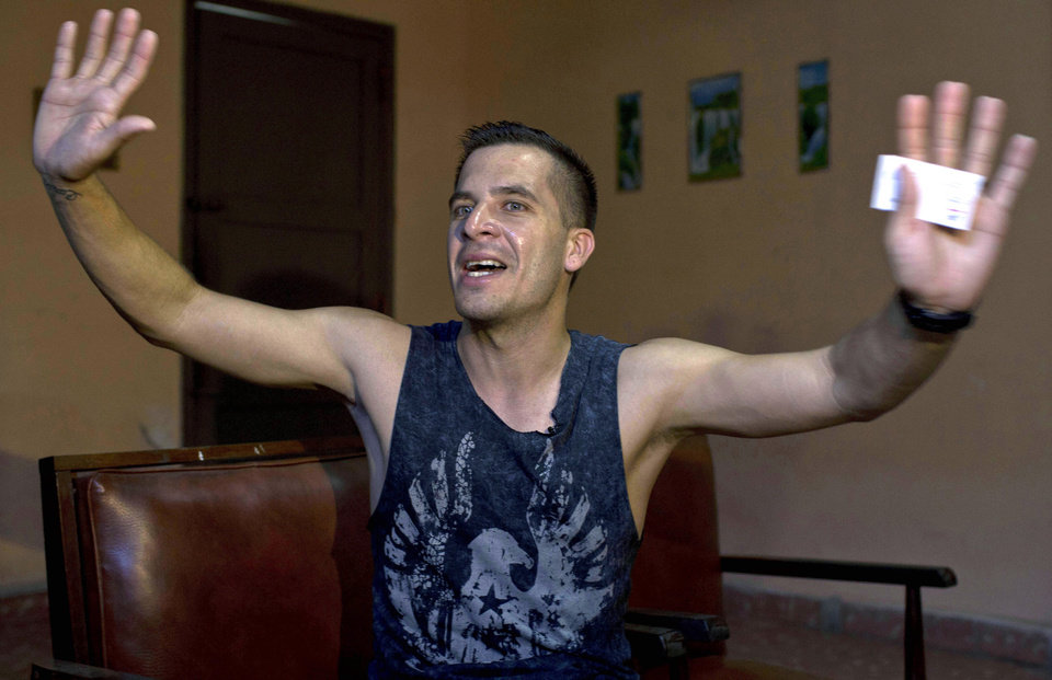 Photo - In this July 11, 2014 photo, Manuel Barbosa, 25, speaks during an interview with Associated Press in Santa Clara, Cuba. Fernando Murillo contacted Barbosa, a founder of the group