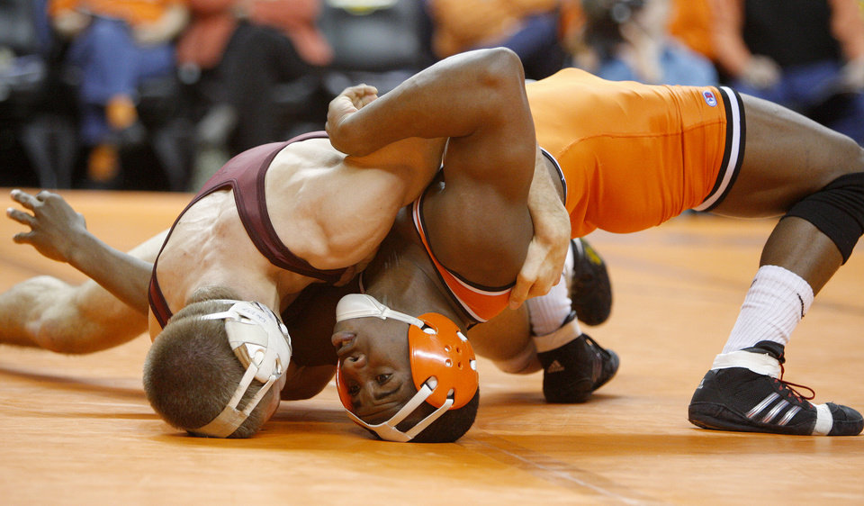 Oklahoma State's Jamal Parks wrestles Minnesota's Dylan Ness, left, in the 149-pound match of the NWCA National Duals championship wrestling at Gallagher-Iba Arena in Stillwater, Okla., Sunday, Feb. 19, 2012. Minnesota won the dual 18-13. Photo by Bryan Terry, The Oklahoman
