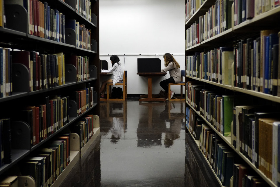 Photo -  Students study in a library on the campus of California State University, Long Beach, in Long Beach, Calif. AP File Photo   Jae C. Hong -  AP