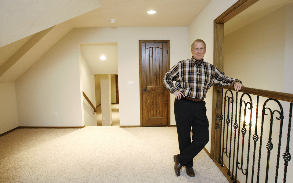 Photo - Homebuilder Jim McWhirter in a furnished model home, 76 Castlegate, in Castlegate housing addition in Choctaw, Friday, Dec. 29, 2007.  McWhirter is the 2006 president of the Central Oklahoma Home Builders Association. By Jim Beckel, The Oklahoman. ORG XMIT: KOD