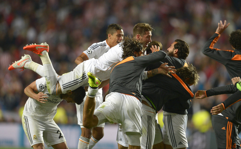 Photo - Real's Sergio Ramos, centre reacts with teammates, at the end of the Champions League final soccer match between Atletico Madrid and Real Madrid, at the Luz stadium, in Lisbon, Portugal, Saturday, May 24, 2014. (AP Photo/Manu Fernandez)