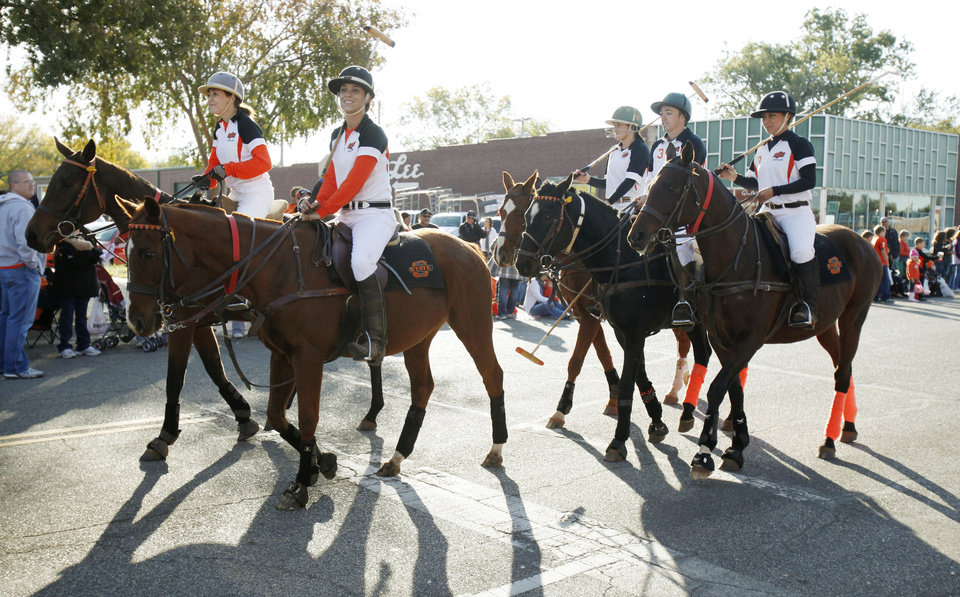 Photo - The OSU Polo team rides in the Oklahoma State Cowboy's homecoming parade in downtown Stillwater, OK, Saturday, Oct. 29, 2011. By Paul Hellstern, The Oklahoman