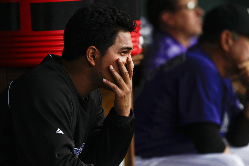 Photo -   Colorado Rockies starting pitcher Jhoulys Chacin sits in the dugout after giving up four runs to the Los Angeles Dodgers during the first inning of a baseball game Tuesday, May 1, 2012 in Denver. (AP Photo/Barry Gutierrez)