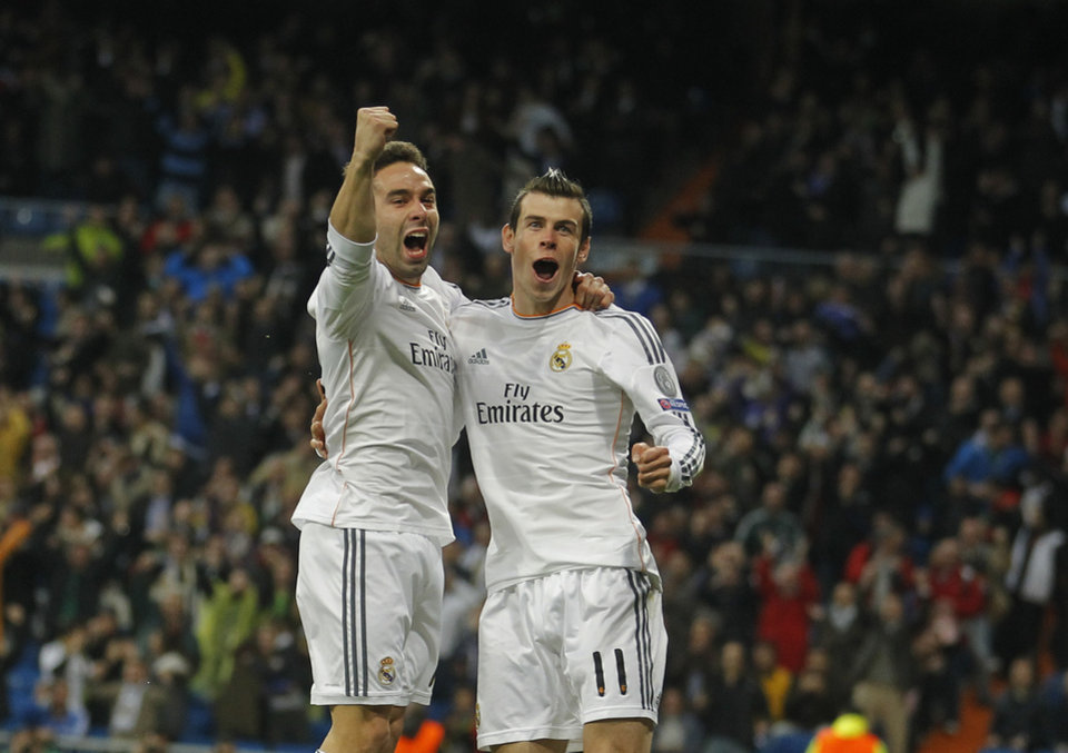 Photo - Real's Gareth Bale celebrates scoring the opening goal with Real's Daniel Carvajal, left, during a Champions League quarterfinal first leg soccer match between Real Madrid and Borussia Dortmund at the Santiago Bernabeu   stadium in Madrid, Spain, Wednesday April 2, 2014. (AP Photo/Paul White)