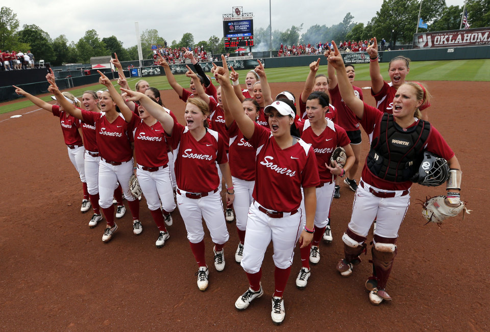 Sooner players celebrate their victory following the NCAA Super Regional softball game as the University of Oklahoma (OU) Sooners defeat Texas A&M 8-0 at Marita Hines Field on Saturday, May 25, 2013 in Norman, Okla. to advance to the College World Series.  Photo by Steve Sisney, The Oklahoman