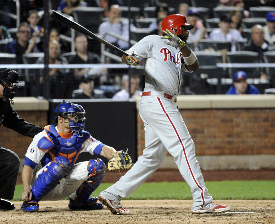Photo - Philadelphia Phillies' Ryan Howard hits an RBI-single as New York Mets catcher Anthony Recker, left, looks on during the ninth inning of a baseball game Saturday, May 10, 2014, at Citi Field in New York. The Phillies defeated the Mets 5-4. (AP Photo/Bill Kostroun)