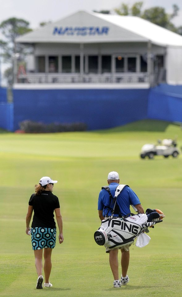 Photo -   Karlin Beck makes her way to the 18th green during a practice round for the Navistar LPGA Tour Classic golf tournament, Monday, Sept. 17, 2012, at RTJ Golf Trail Capitol Hill in Prattville, Ala. (AP Photo/The Montgomery Advertiser, Mickey Welsh) NO SALES