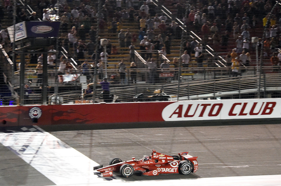 Photo - Tony Kanaan takes the checkered flag to win the IndyCar Series season final 500 mile auto race Saturday, Aug. 30, 2014, at Auto Club Speedway, in Fontana, Calif. (AP Photo/Will Lester)