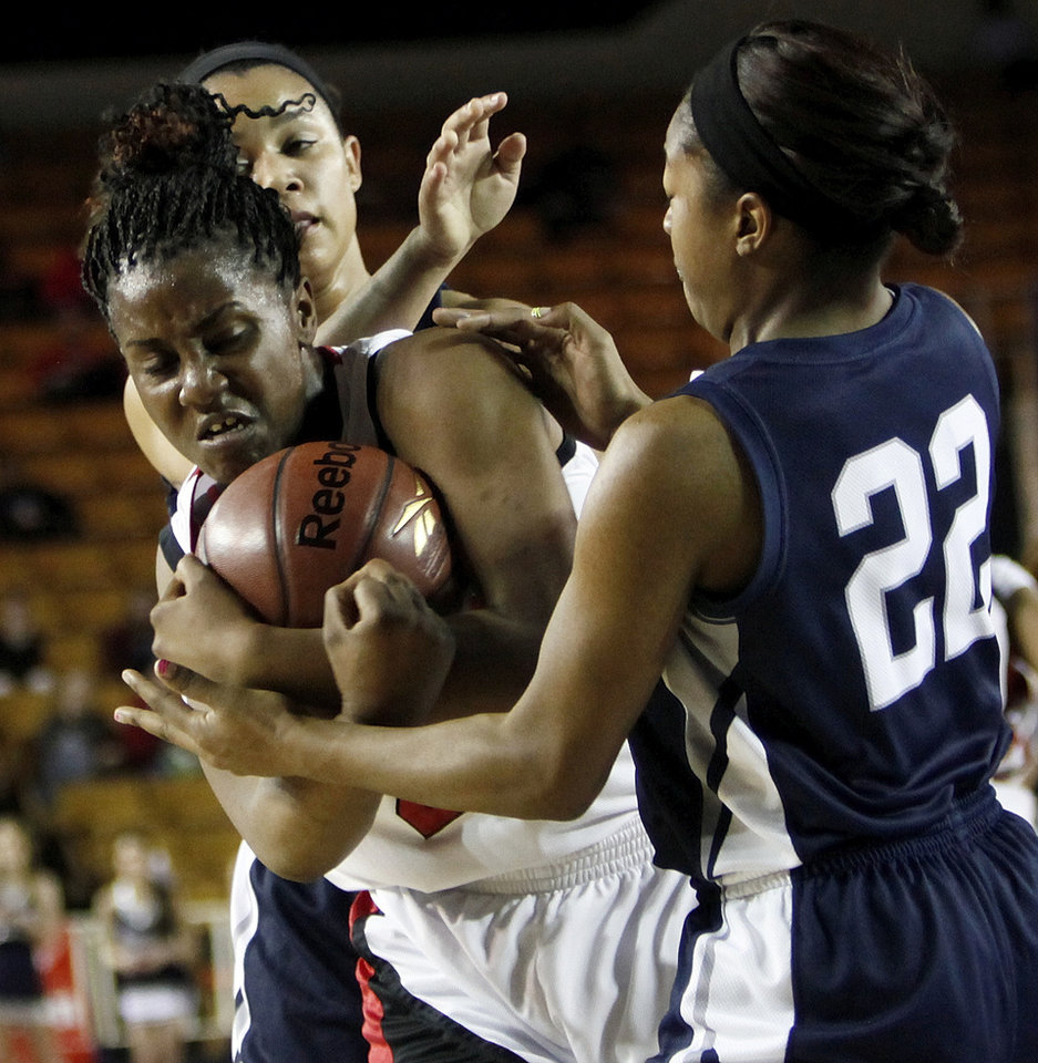 East Central's Felecia Achilefu (24) battles for the ball with Shawnee's Kelsee Grovey (23), back, and Diamond Young (22)  during the Class 5A girls high school basketball state tournament championship game between Shawnee and East Central at the Mabee Center in Tulsa, Okla., Saturday, March 10, 2012. Photo by Nate Billings, The Oklahoman