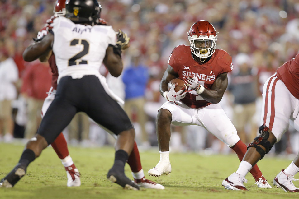 Photo - Oklahoma's Trey Sermon (4) carries the ball during a college football game between the University of Oklahoma Sooners (OU) and the Army Black Knights at Gaylord Family-Oklahoma Memorial Stadium in Norman, Okla., Saturday, Sept. 22, 2018. Photo by Bryan Terry, The Oklahoman