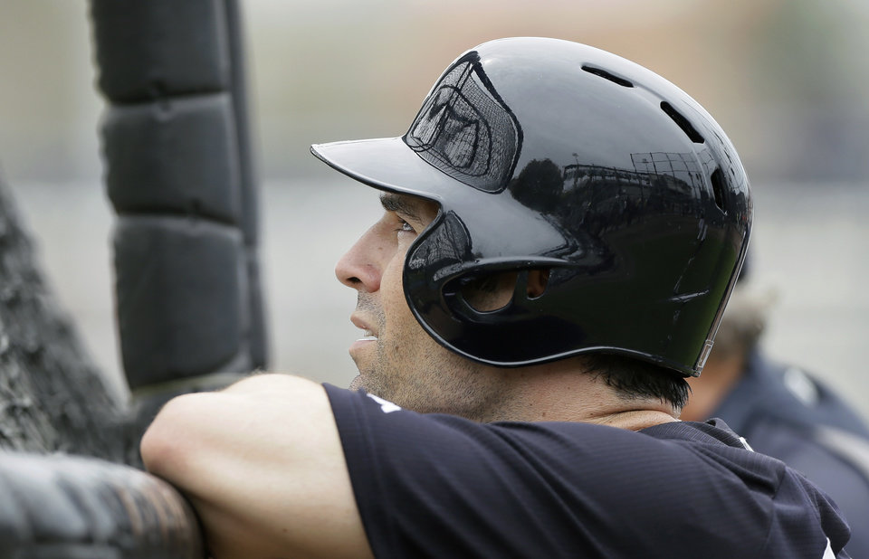 Photo - New York Yankees infielder Scott Sizemore waits to hit in the batting cage during spring training baseball practice Friday, Feb. 21, 2014, in Tampa, Fla. (AP Photo/Charlie Neibergall)