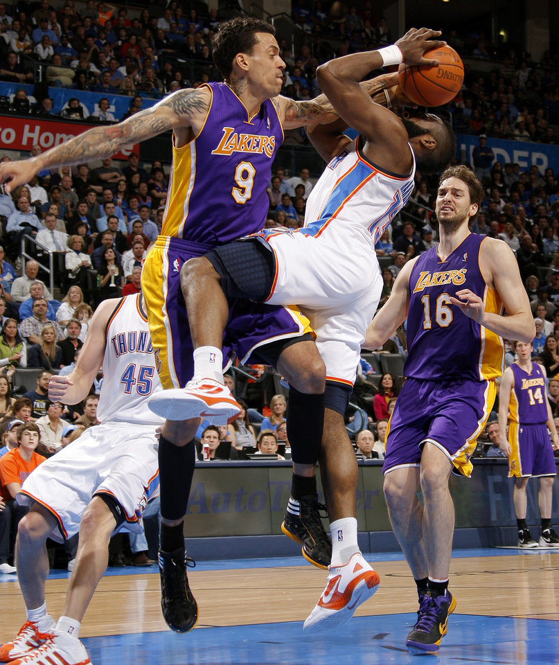 Photo - Oklahoma City's James Harden (13) is fouled by Los Angeles' Matt Barnes (9) during an NBA basketball game between the Oklahoma City Thunder and the Los Angeles Lakers at Chesapeake Energy Arena in Oklahoma City, Thursday, Feb. 23, 2012.  Oklahoma City won 100-85. Photo by Bryan Terry, The Oklahoman