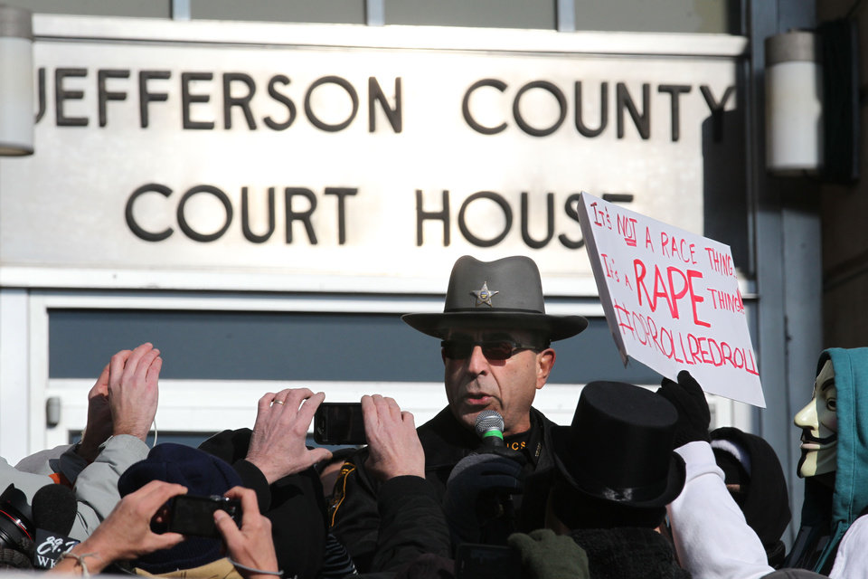 Photo - Jefferson County sheriff Fred Abdalla addresses the crowd at the Jefferson County Courthouse in Steubenville, Ohio, Saturday, Jan. 5, 2013. Authorities investigating rape accusations against two high school football players in eastern Ohio launched a website Saturday as interest in the case balloons, an extraordinary step designed to combat the misperception