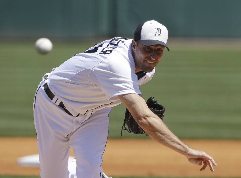Photo - Detroit Tigers starting pitcher Max Scherzer throws during the first inning of an exhibition spring training baseball game against the Tampa Bay Rays, Friday, March 29, 2013 in Lakeland, Fla. (AP Photo/Carlos Osorio)